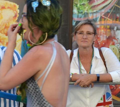 woman watching pride parade