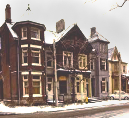photo from 1974 of William Sexton houses at the corner of Bay Street and Scollard in Yorkville, 4 row houses that together look like one large brick house