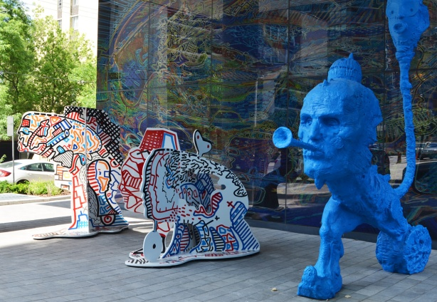 stargate sculpture series, redpath ave in toronto, public art, yellow and blue alien figures and two glass murals