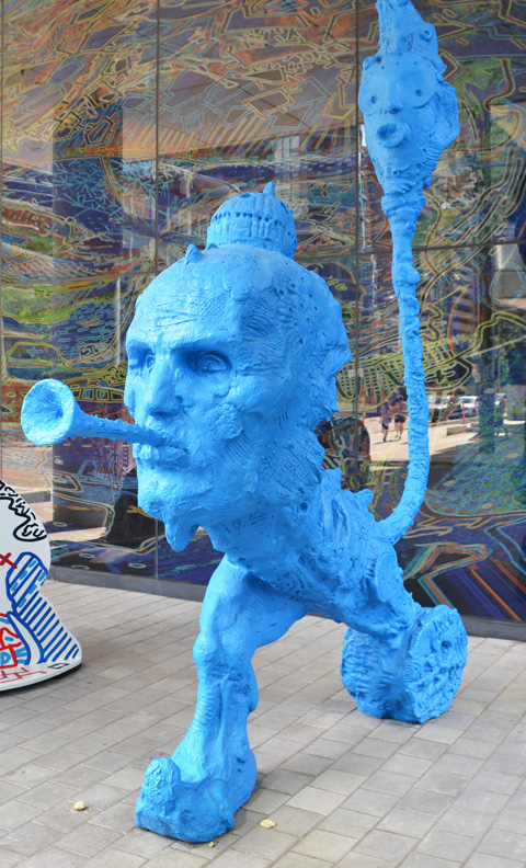 stargate sculpture series, redpath ave in toronto, public art, yellow and blue alien figures and two glass murals - blue alien blowing a long horn