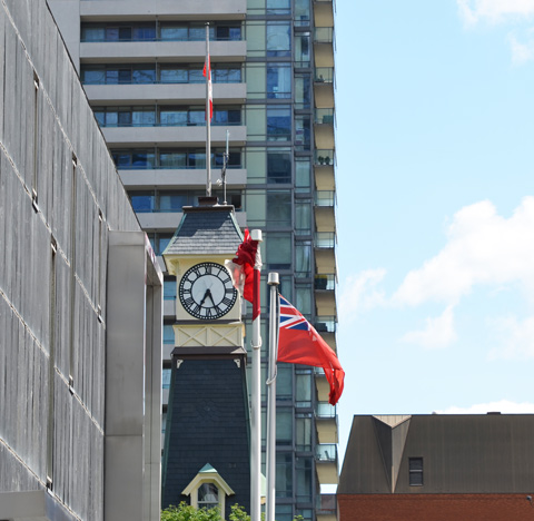 Yorkville fire hall clock tower and flags