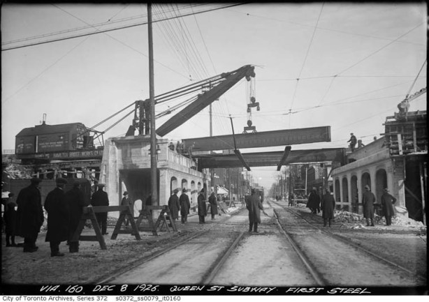 old black and white photo from 1915, City of Toronto Archives, of building of the railway bridge over Queen East at Riverdale station