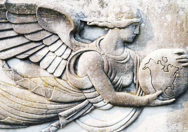 bas relief sculpture on stone of a winged woman holding a globe, earth