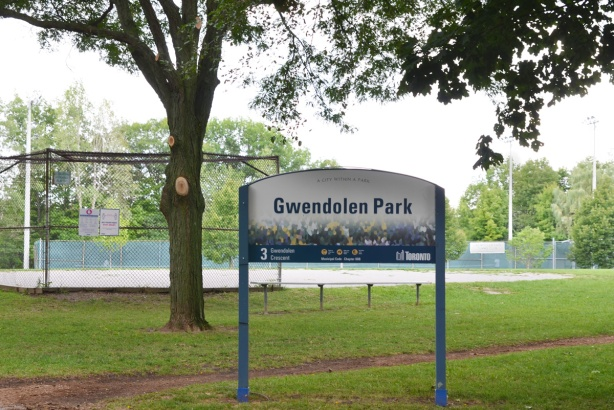 Gwendolen Park sign with tennis courts in the background
