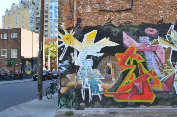 mural in an alley on the north side of Queen West