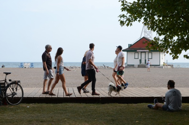 three couples on the boardwalk, one couple is walking their dog