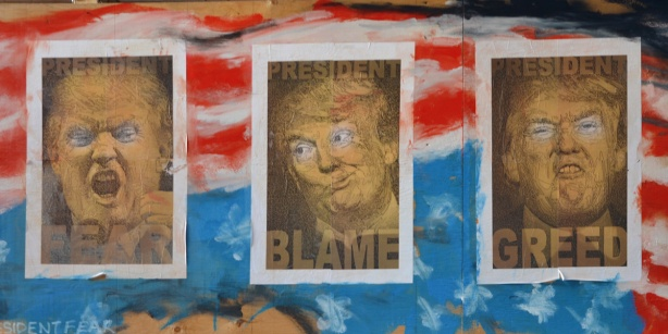 posters on a wall in Graffiti Alley, of president trump, parody, president ego and president greed, blame, fear, on abstract America flag, caricatures of Trump just his face in each poster
