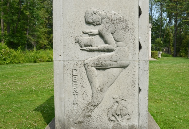 relief sculpture representing province of alberta in Guild inn garden, man holding a sheep, with rodeo cowboy beloww