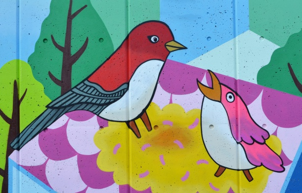 two birds in a mural by K J Bit Collective