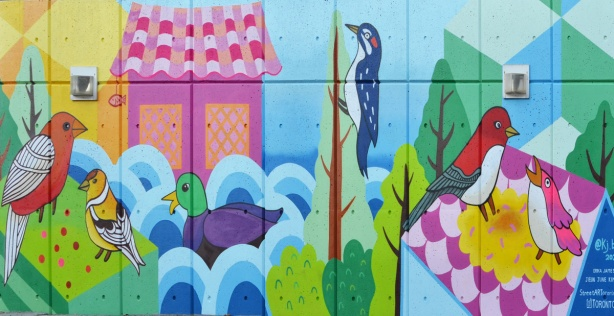 mallard duck in water and woodpecker on tree, part of Flock Together, a mural by Jieun June Kim and Erica James