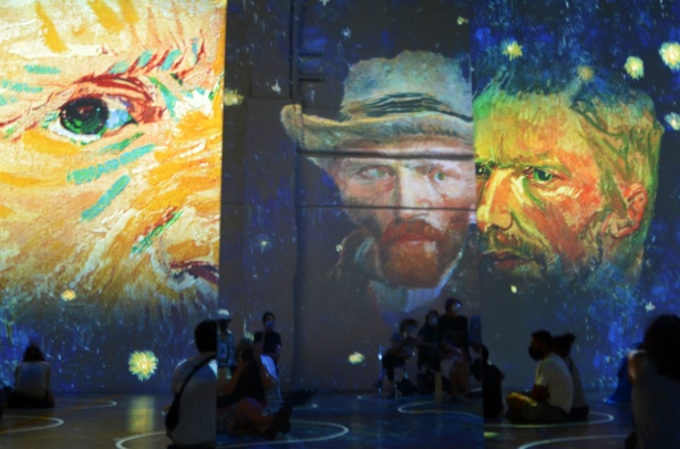 Vincent Van Gogh Immersive exhibit - large faces of Van Gogh projected on the wall, from self portrait paintings