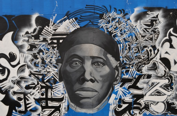 portrait of a black man in the middle surrounded by calligraphy in black and white