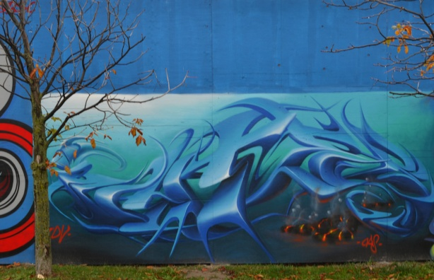 mural, in blues, stylized waves, or text, could be either