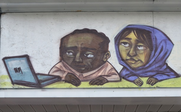 from a mural by elicser on an old 7-Eleven building on the Danforth, a couple is looking at an open laptop together, brown skin, woman in blue head scarf