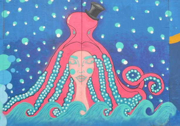 mural on hoardings, a woman with long braided turquoise hair under a pink octopus wearing a black top hat, mural by dbetty13, Desire Betty