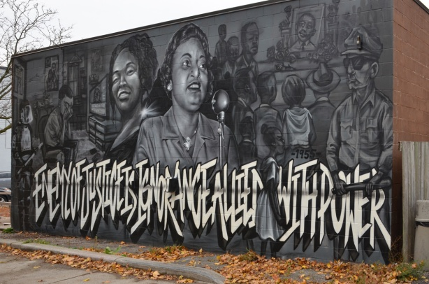 mural with words, Enemy of Justice is Ignorance allied with power. Black and white and grey