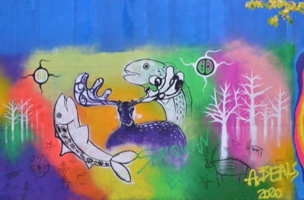 mural with two fish making a circle with a deer in betwee, some trees on both sides, multi coloured background