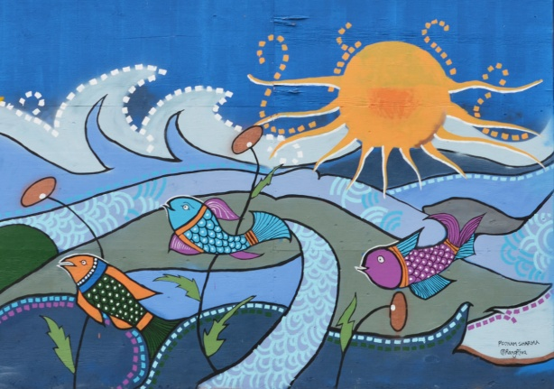 mural of stylized fish swimming in the water with the sun shining down from above