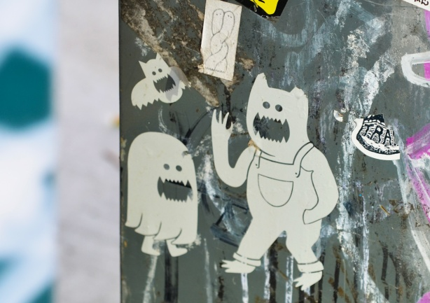 ghostly white paper slaps on a met box, ghost faced bat, also bear in overalls,
