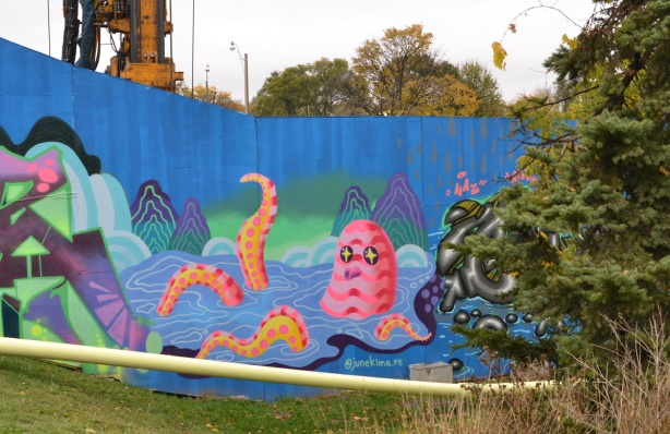 a mural of a pink striped octopus sitting in the water with head above water and some tentacles sticking up above the water, by Jeun June Kim