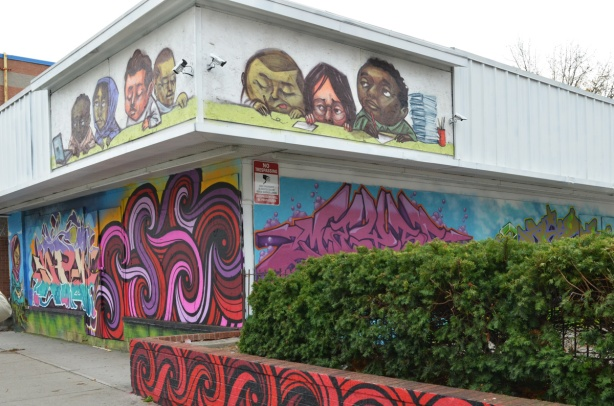mural by elicser along with text tag street art