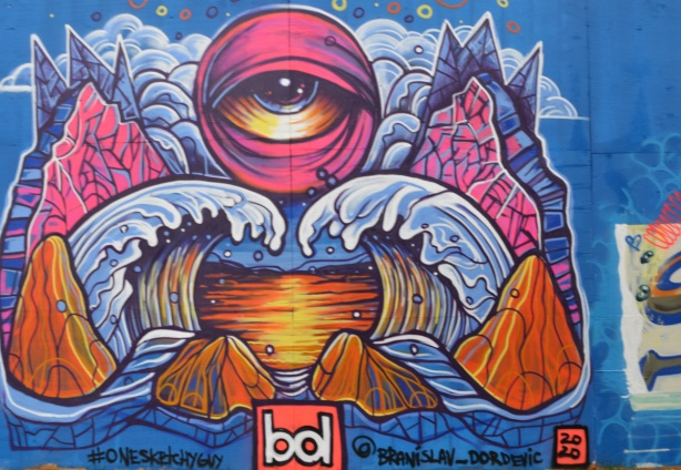 mural, a large eye at top center, ice bergs, lake, ice and snow by onesketchyguy
