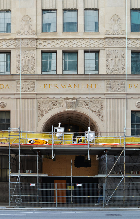 scaffolding at the front, cleaned up stone facade of the Canada Permanent Building on Bay street