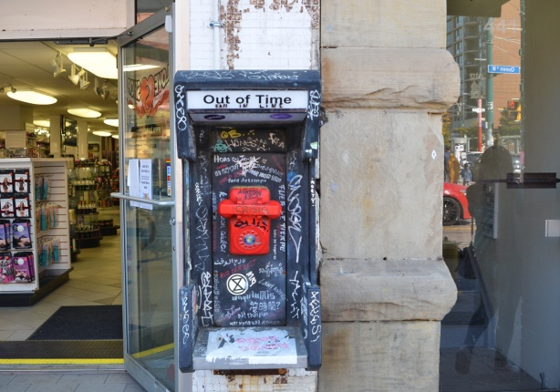out of time, red emergency phone, street art, in old wall phone booth