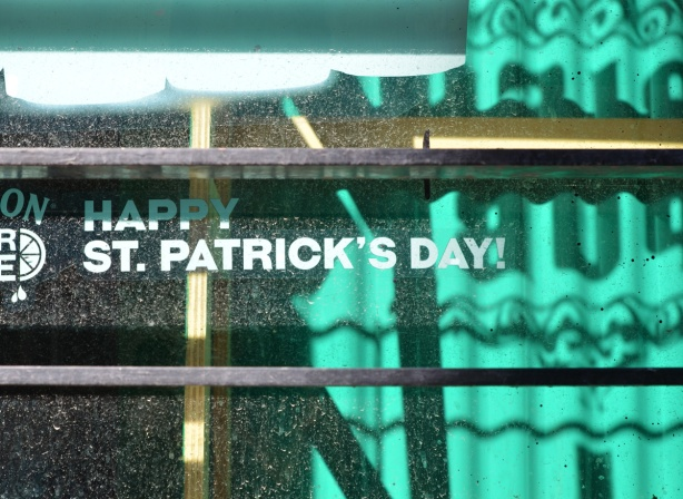 Happy St. Patricks Day sign in the window of a restaurant