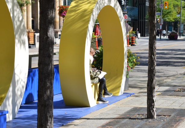 a round yellow circle around a bench on King Street, part of decorations for Tiff