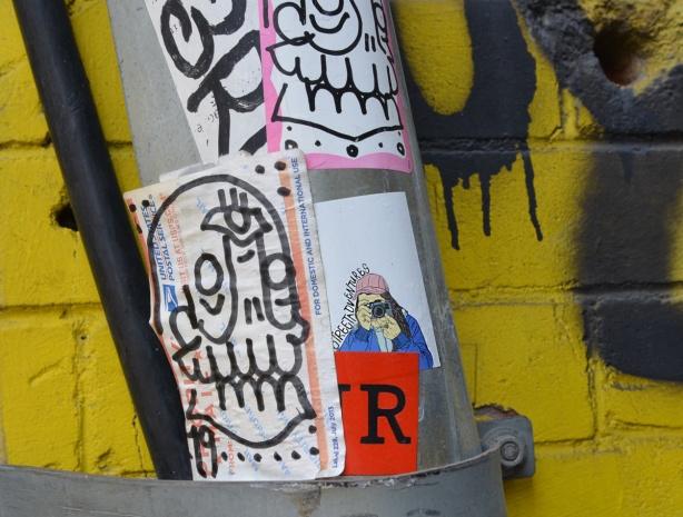 stickers on a pole