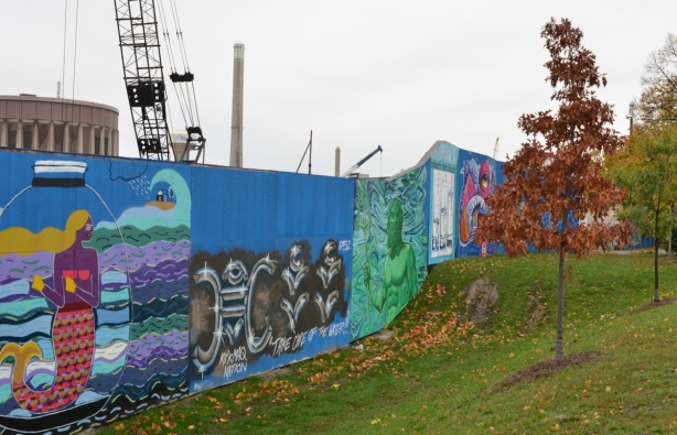 looking uphill at murals on hoardings near Ashbridge Bay water treatment facility, wallnoize project,