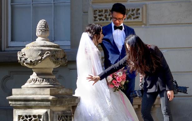 photographer setting up a wedding photshoot at Osgoode Hall