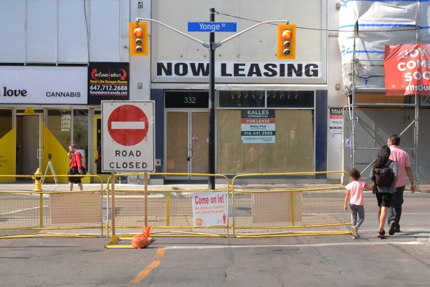 empty stores on yonge street, with a now leasing sign in the window