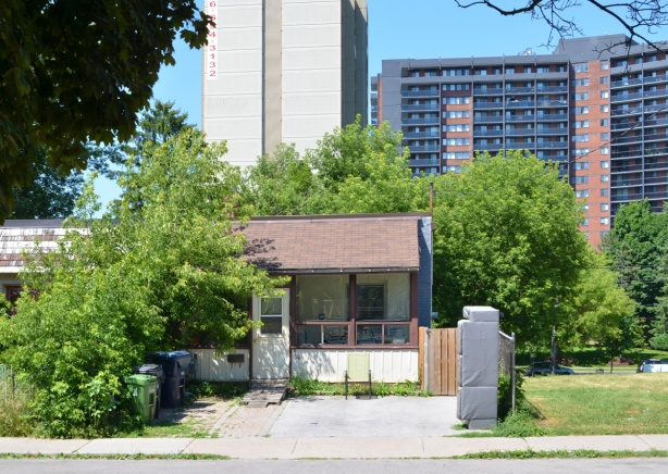 bungalow in the foreground, highrise apartment building in background
