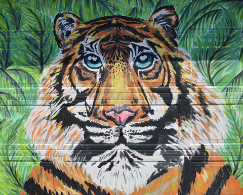 mural of a tiger's face on a garage door