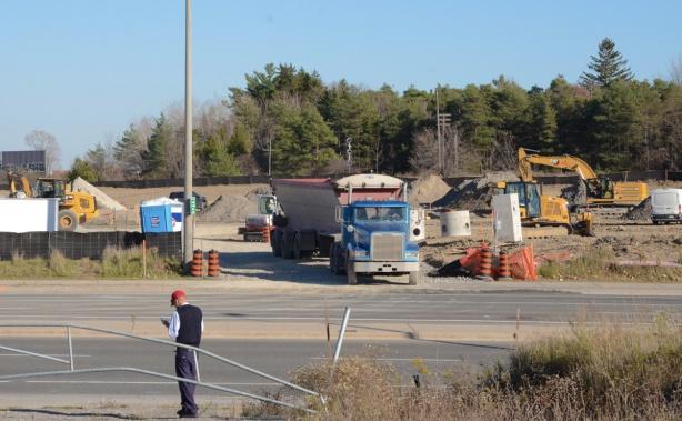 dump truck leaving a construction site