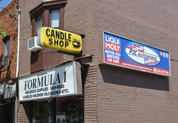 signs on exterior of store, Formula 1 store, sells candles and religious items, also sign advertising Liqui Moly motor oils, additives, and car care from PJC Autoworks
