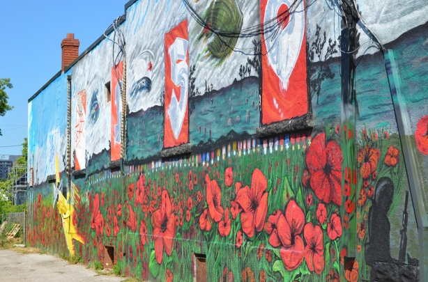 mural in the side of Royal Canadian Lion branch 73, Oakridge Branch, poppies, a yellow airplane, beside an alley,