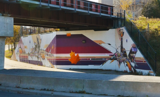 maple leaf and stripes, under the bridge, part of a mural by Mediah IAH Digital, train underpass on Finch Ave in Scarborough