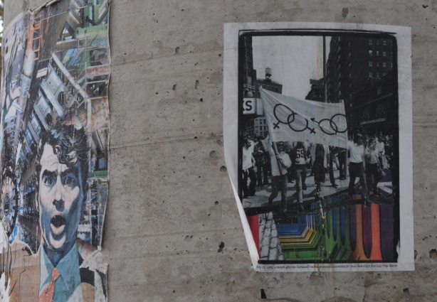 posters on a concrete utility pole