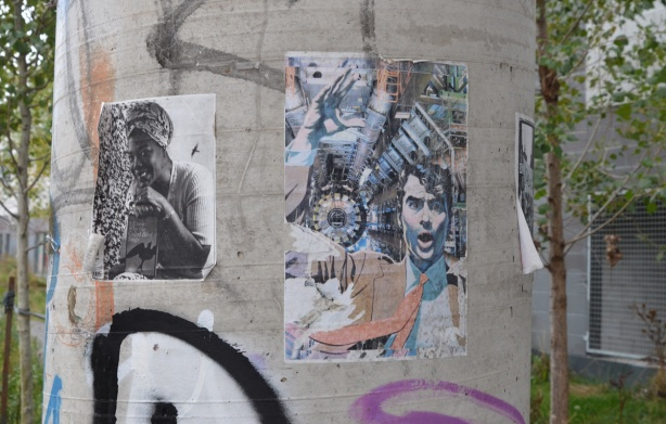 paper posters on a concrete pole
