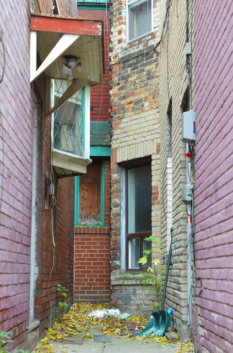 very narrow entranceway between two buildings