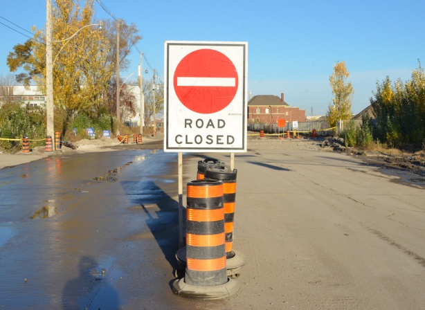 road closed sign in the middle of the street, commissioners street in the port lands