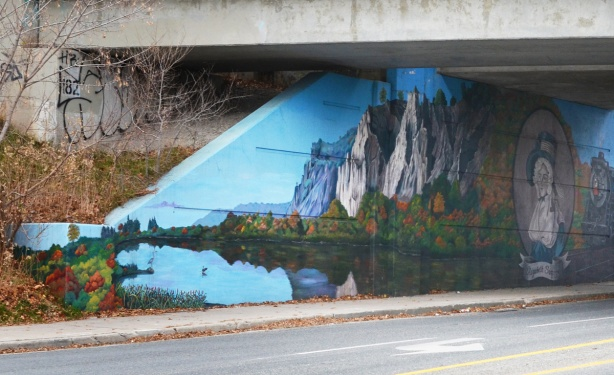 part of mural on side of railway underpass, Scarborough bluffs and Lake Ontario