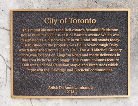 bronze city of toronto plaque describing the mural on Warden ave