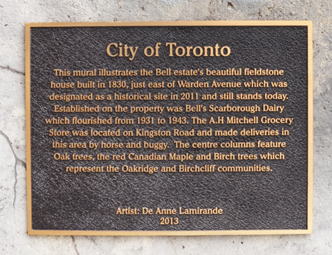 bronze city of toronto plaque describing the mural on Warden ave