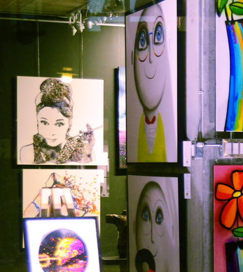 pictures in a gallery window, most pictures are of faces