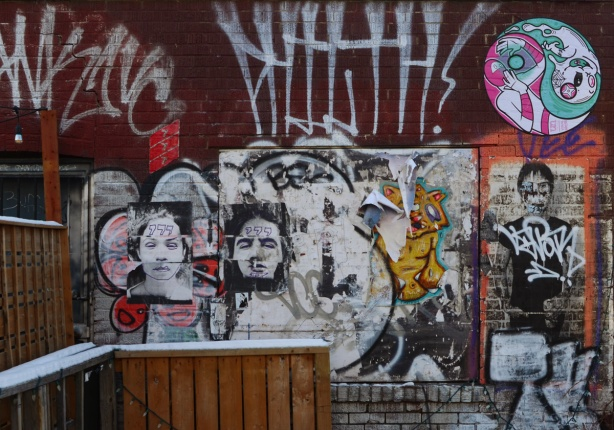 posters and paste ups on a wall in Kensington,
