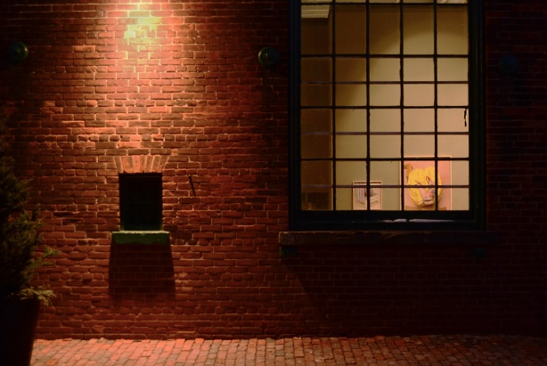 an art gallery window from outside, evening,